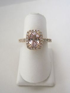 Ladies Rose Gold, Diamond and Antique Cushion Cut Pink Sapphire Halo Engagement ring.  One of a kind! www.jensenjewelers.net