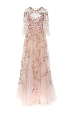 Rendered in silk, this **Marchesa** gown features a soft A-line silhouette with plunging neckline and peasant sleeves.