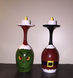 """Grinch vs Claus""  hand painted wine glass candle holders"
