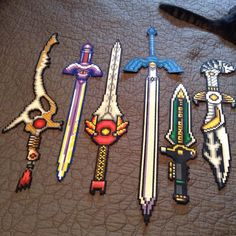 I will end Power Rangers Month with a bunch of swords (and cat butt). Perler Beads, Hamma Beads 3d, Perler Bead Art, Fuse Beads, Perler Bead Templates, Pearler Bead Patterns, Perler Patterns, Motifs Perler, Pixel Pattern