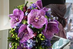 Don't know if I LOVE the flowers, but do like the colors. The Flower Magician: Forget Me Not & Vanda Orchid Lavender Blue Wedding Bouquet