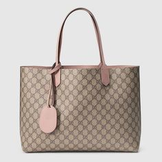 Shop the Reversible GG medium tote by Gucci. A lightweight medium size tote that packs in more than meets the eye. Made in our innovative reversible leather, patented exclusively to Gucci. Gucci Handbags, Tote Handbags, Handbags Online, Luxury Handbags, Leather Purses, Leather Handbags, Gucci Tote Bag, Gucci Bags, Tote Purse