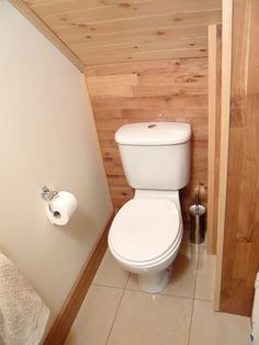 Beadboard Panel Hides The Bathroom Plumbing And Toilet Roll Holder Makes The Door Handle Diy