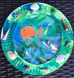 Paper plate porthole fish craft for kids! Perfect art project for an ocean theme