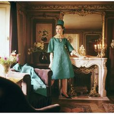 Dior's teal organza dress and coat are made in three separate layers, photographed by Mark Shaw at Suzanne Luling's (directrice at Dior) Left Bank apartment, 1960