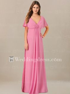 Empire summer mother of the bride dress has the perfect look for a wedding as well as for any other special occasion. Highlights include a V shape neckline and butterfly sleeves for a fashion modesty. A fabulous flower is adorned at the center bust. Full length skirt drapes effortless to floor. Zipper back closure. Available in 60 colors, shown in Petunia.
