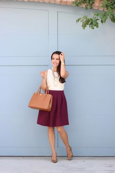 Pleated Burgundy skirt, lace top, necklaces, gold watch, leather purse and leopard pumps   // Click the following link to see outfit details and photos:  http://www.stylishpetite.com/2014/09/burgundy-and-lace.html
