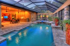 sliders from master bedroom to the hot tub area.  love everything about this!  area for decorative pots. shape of the pool