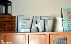 """Anthropologie Inspired Zinc Letters. You could spell the word """"EAT""""  in the kitchen, or """"WASH"""" in a laundry room, or """"READ"""" in a library. So many possibilities with this easy craft!"""