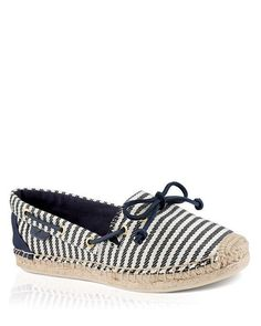 Round toe; slip on; metallic gold-tone rawhide laces Available in full and half sizes Fabric upper, fabric lining, jute and rubber sole Imported Size Chart: About Brand: About Sperry Paul Sperry, foun