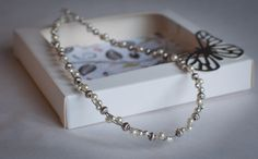 Cream pearl and silver necklace with a hint of sparkle by ButterflyJade on Etsy https://www.etsy.com/listing/210044501/cream-pearl-and-silver-necklace-with-a