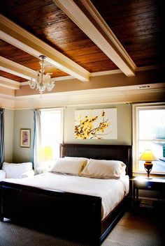 Master bedroom wood ceiling. I like how the beams are painted a different color