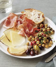 Tapas Plate With Marinated Chickpeas Recipe.  You don't need the Manchego, prosciutto, olives or bread if you're serving as appie.