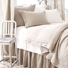 Easy comfort: layer our clean-lined, pleated linen duvet, shams, and bed skirt with a soft matelassé and shams and white embroidered sheets.