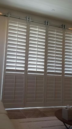 Image result for DIY barn door window covering with recycled plantation shutters