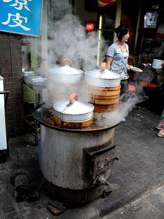 This is a little street vendor selling dumplings or jiao zi.