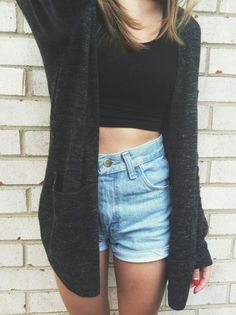 High-waisted jean shorts, a black crop top, and a cardigan. Super cute together.