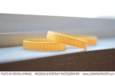 The bride and groom had both lost their mom to cancer around the same time. The entire wedding party wore LIVESTRONG bracelets as a reminder to stay strong and always remember.