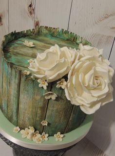 I was asked last minute to create an engagement cake for family friends and the only suggestion was vintage. I recently saw a picture of a distressed wooden crate with a rose in a vase on pinterest and I decided to use that as inspiration. I used a wood textured rolling pin that I git from Cakes by Angela Morrison and then I hand painted all the distressed look effect. I also made wired roses for the first time. Loved making this cake :-)
