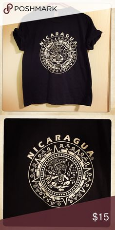 Vintage Nicaragua T-Shirt  Beautiful t-shirt in great condition. Sized as medium but is more of a small/medium. Color is navy. Tops Tees - Short Sleeve