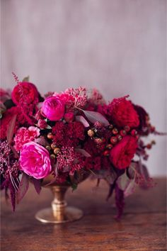 a rich red and pink berry toned floral arrangement