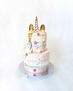 2 tier unicorn cake with mirror gold unicorn cake topper