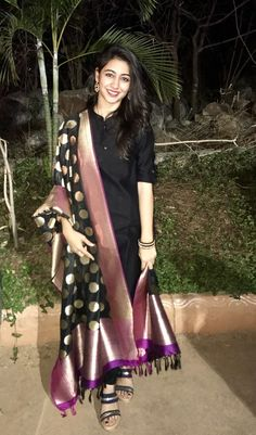 Simple yet elegant. Plain black kurta with a rich black & purple Benaras dupatta