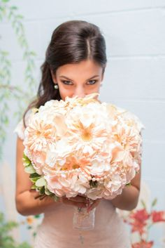Full bridal bouquet with pearl accents | Photographer: IMR productions