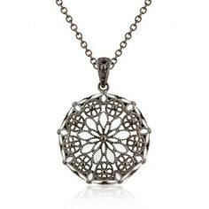 Black Floral Round Pendant - a sterling silver necklace