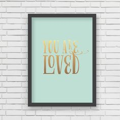 "This gold and mint green ""You Are Loved"" print by @LucyDarlingShop is perfect for a nursery gallery wall!"