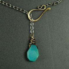 Brass hook, adjustable front drop.  Turquoise scarab, if I have any left that are fully drilled.