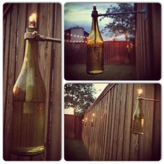 Wine bottle tiki torches across our back fence!