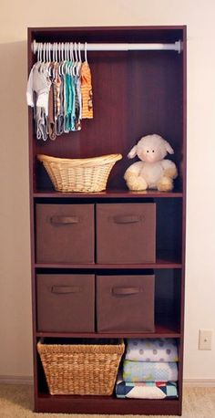 Turn a bookshelf into a mini-closet for the baby's room.