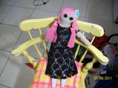 "the ""molly"" dolly. made from tea dyed pillow case and scrap fabric. button eyes."