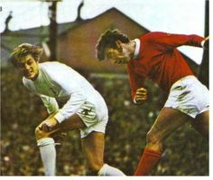 15th August 1970. Leeds United striker Allan Clarke challenging Manchester United's David Sadler in this opening day of clash at Old Trafford.
