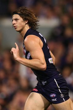 Nathan Fyfe Photos - Nathan Fyfe of the Dockers celebrates a goal during the round 10 AFL match between the Fremantle Dockers and the Richmond Tigers at Domain Stadium on June 2015 in Perth, Australia. - AFL Rd 10 - Fremantle v Richmond Adorable Guys, Male Poses, Athletic Men, Running Shorts, Gorgeous Men, Rugby, My Boys, Athletes, Sexy Men