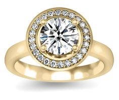 Halo Diamond Ring in Yellow Gold (1/4 ctw)  Twenty four round cut diamonds are pave set in this yellow gold diamond engagement ring setting, accenting your choice of center diamond. 1/4 carat total diamond weight. Proudly made in the USA.