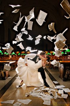 Boston Public Library Wedding: Erika and Chip Tear Up the Place. Books and love flying - wedding photo
