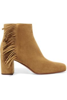 Saint Laurent's 'Babies' ankle boots are trimmed with '70s-style fringing. Made in Italy from the softest tan suede, the pair has a supportive block heel and flattering almond toe. Wear yours with everything from summer dresses to kick-flare jeans.