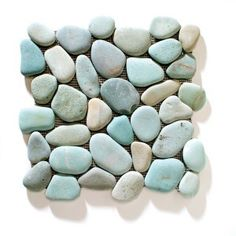 Sarah Richardson's tips on how to design a small bathroom | Have fun with texture: Try pebble mosaics on the floor of your new shower stall. They'll add a whole new sensory experience to your morning routine. | Ocean stone tiles in Turquoise, $ 13/sq ft, Kuda Imports.