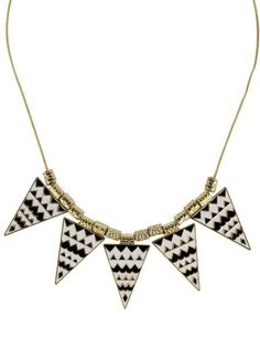 Trending aztec-print geometric tribal neckpieces  via @Roposo