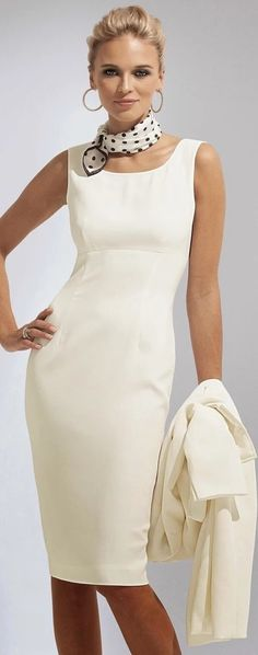 Creamy white empire knee length sheath dress. White and black polka dot scarf tied around the neck. Big gold hoop earrings. White coat in left hand. Both sharp and accessible. Style Planet