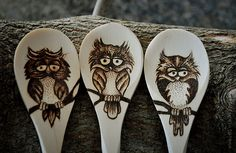 Owls on one side, branches on the other
