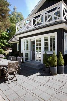 AnneEriksen Bøgesvang lives with her family in a Swedish wooden house near Helsinge. Black House Exterior, Exterior House Colors, Exterior Design, Future House, My House, House Extensions, Wooden House, Home Additions, Scandinavian Home