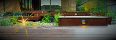 This outdoor lighting system features downlights built into the decking steps.  See the whole Bentleigh project at www.intrinsiclandscapes.com.au
