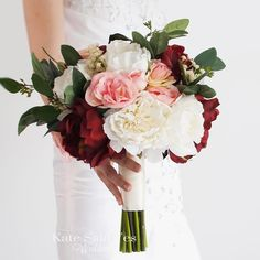 Peonies roses and greenery make a stunning and rustic autumn wedding bouquet. Silk bridal bouquet by Kate Said Yes Weddings. #wedding #weddingbouquet #silkbouquet #katesaidyesweddings #etsyweddingteam #bride #bridetobe #weddingday #proguidevendor #theweddingpages #perfectpalette #bridalbouquet #weddingplanning #foreverbouquet #engaged #shesaidyes #peonybouquet #peony #peonies #flowers #summerwedding #peonywedding #weddingflowers #pink #rustic #rusticwedding #rusticbouquet