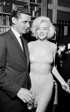 Marilyn Monroe in her Jean Louis dress after singing 'Happy Birthday' to JFK. Why Marilyn Monroe's 'Happy Birthday, Mr President' dress fetched a record £3.8 million at auction.