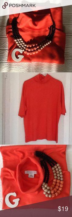 "Liz Claiborne woman turtleneck Orange/coral color, 83% rayon, 17% nylon, 23"" armpit to armpit, 3/4 sleeves, great condition! Liz Claiborne Tops"