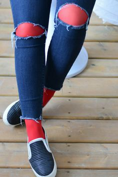To add a pop of colour to your daily looks, wear a pair of Red Tights under your ripped jeans.