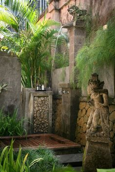 I enjoy the peaceful feeling created by the shallow ponds of water surrounding wooden walkways; definitely something I would love to incorporate. However, less busy, with no statues. The tropical plants seem to naturally blend in the design. I enjoy the cool outdoor shower which seems to hide in the ancient design, merging the ancient and modern.: